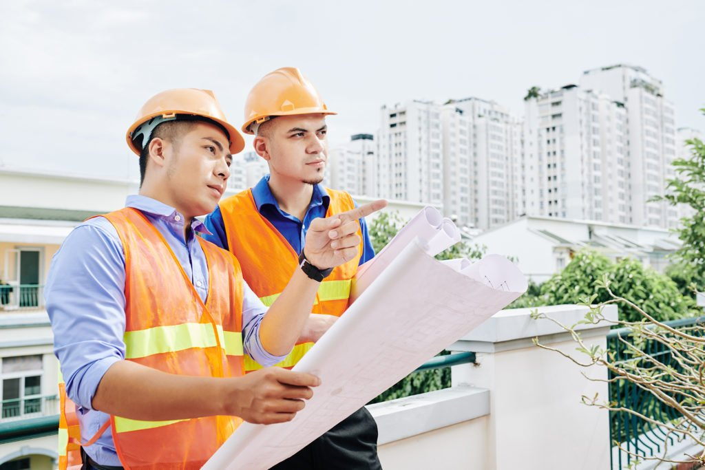 Construction workers discussing project